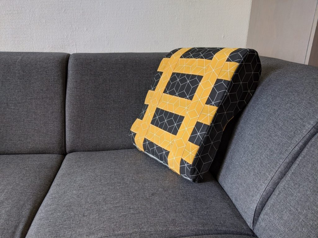 shows the prototype of the pillow on the couch